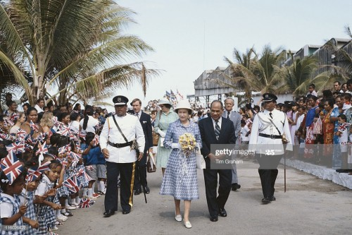Hammer DeRoburt (1922-1992), President of the Republic of Nauru, and Queen Elizabeth II attend a gar